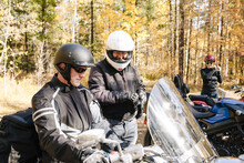 Men In Helmets Preparing To Ride Motorbikes