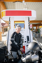 Motorcyclist Refuelling At Gas Station