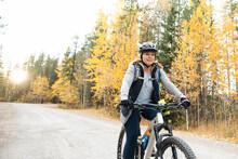 Woman Riding Bike Through Forest