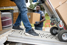 Male Movers Unloading Moving Van