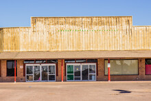 Obsolete & Weathered Store Front Commercial Building With Blocked Out Windows