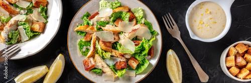 Fotografie, Obraz Caesar salad panorama on a dark background