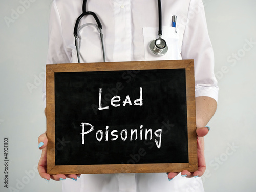 Photo Healthcare concept meaning Lead Poisoning with sign on the sheet.