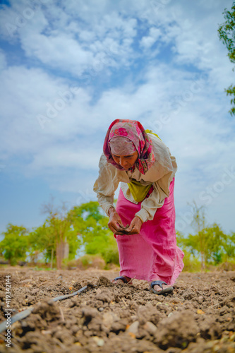 Indian lady working at field Fototapeta