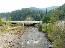 A Bridge Crosses The South Fork Coeur D' Alene River Near Silverton, Idaho. Fish Travel Up This River Every Year To Reach Spawning Grounds In The Coeur D' Alene Lake...
