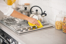 Close Up Of A Housewife Doing Cleaning The Gas Stove