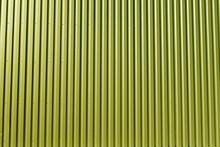 Ridged Yellow Metal Wall Background.