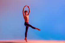 Teenage Ballet Boy Dancer Dances Barefoot Under A Colored Light.