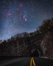 The Winter Night Sky And Constellation Orion Shining Over The Mary's Rock Tunnel In Shenandoah National Park Along Skyline Drive.