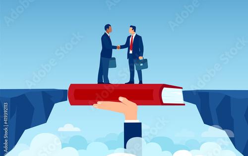 Vector of handshaking business men overcoming disagreements bridging the gap hav Fotobehang