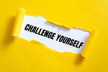CHALLENGE YOURSELF Message Written Under Torn Paper.