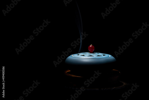 Fotografia, Obraz incense burner censer with smoke on black background.
