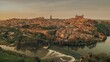 Time-lapse above aerial drone point of view Toledo historical picturesque city of Spain surrounded by Tagus river located on hilltop, day evening scene view. Castilla–La Mancha. Timelapse hyper lapse