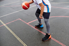 Cropped Image Of Unrecognizable Male Playing Basketball At The Court. Sport Concept.