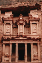 Exterior Aged Historic Al Khazneh Temple With Ornamental Details And Columns Carved Out Of Rock Located In Petra