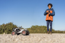 Afro Boy Playing In The Park With Radio Control Car