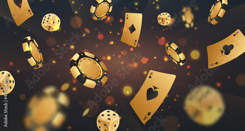 Foto Falling golden poker chips, tokens, dices, playing cards on black background with gold lights, sparkles and bokeh