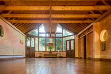 Interior Of Spacious Meditation Hall In House With Potted Plants And Parquet In Daytime