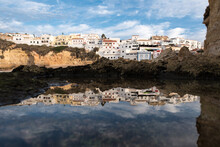Carvoeiro Beach With Village Building On Top Of Cliff On The Seacoast In Algarve Portugal