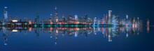 Night Cityscape Of Chicago With Contemporary Buildings And Towers Illuminated By Colorful Lights Reflecting In Calm Lake Water