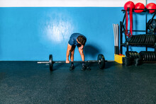Powerful Male Athlete Without Hand Lifting Heavy Weight During Functional Training Near Sports Equipment In Gymnasium