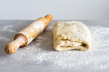 Wooden Rolling Pin Near Soft Dough With Flour During Cooking Process In Countertop