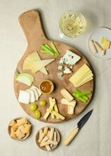 From Above Various Cut Cheese On Wooden Board With Croutons Placed On Table