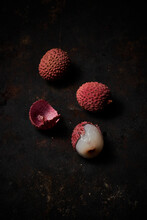 Top View Of Lychee On Dark Rustic Wooden Background