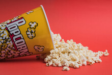 Bowl Full Of Popcorn On A Red Background