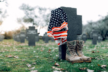 National American Flag And Army Flag Placed On Gravestone In Military Cemetery On Early Autumn Day