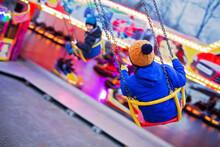 Child, Cute Boy Riding Chain Swing Carousel On Sunset, Motion Blur