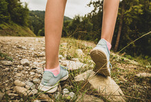 Recreation - Hiking Among The Hills. Girl Legs In Pastel Blue Sneakers.