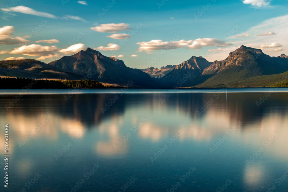 Fototapeta dramatic, peaceful and  serene summer  sunset photo of Lake McDonald in Glacier National Park in. Montana.
