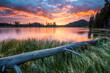 Leinwandbild Motiv dramatic and vibrant summer sunrise in Sprague Lake in Rocky Mt National Park