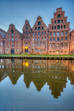 The Medieval Salzspeicher With The Trave River At Dawn, Seen In Luebeck, Germany