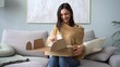 Attractive Indian mixed-race woman customer opening parcel box at home