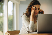 Woman Looking Stressed Out While Working From Home