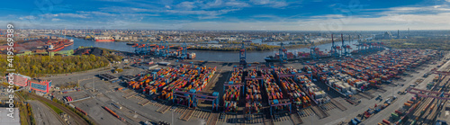 Fototapety, obrazy: Panorama aerial view of seaport on the river Elbe in Hamburg. View of the container terminal in Hamburg-Altenwerder, loading and unloading of various shipping container and the Hamburg freight station
