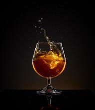Glass Of Whiskey With Ice Splash