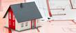 Leinwandbild Motiv model home standing on blueprint plan