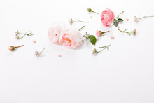Flowers Composition. Frame Made Of Pink Rose Flowers On White Background. Flat Lay, Top View