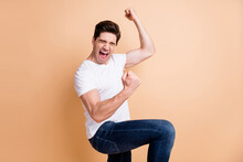 Profile Side Photo Of Lucky Cheerful Man Closed Eyes Scream Yeah Raise Fists Isolated On Pastel Beige Color Background