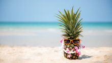 Summer In The Party.  Hipster Pineapple Fashion In Sunglass And Listen Music On The Sand Beach Beautiful Blue Sky Background.  Creative Art Fruit For Tropical Style