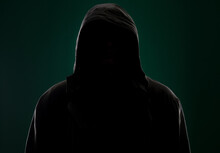 Dark Portrait Of A Hidden Person On A Green Background