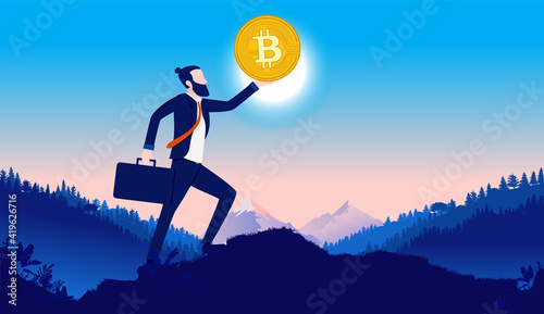 Stampa su Tela Businessman holding Bitcoin - Proud business person holding coin in hand, lifting in up to the sky