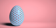 Easter 3D Render Concept: A Single Decorative Glossy Blue Egg With Beautiful Red Dot Design On Pink Background With Smooth Shadow And Large Copy Space. Illustrated Graphic Object. Shiny Surface