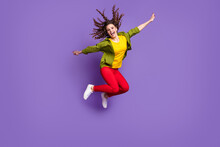 Full Size Photo Of Young Funky Funny Smiling Cheerful Girl Jumping With Flying Hair Isolated On Violet Color Background