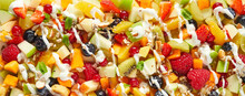 Background Of Appetizing Assorted Fruits And Berries Sprinkled With Yogurt