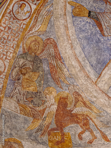 Fotografie, Tablou an angel for Matthew and a lion as the  symbol of saint Mark a romanesque painti