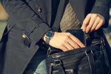 Stylish Woman With A Bag And Smartphone. Hands Closeup.